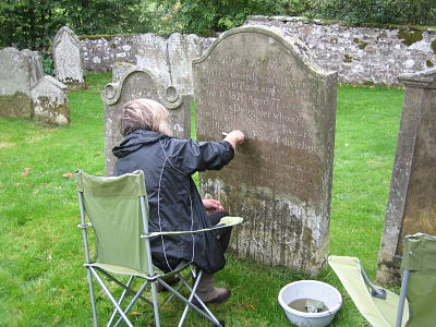 cleaning the gravestones